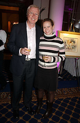 TV producer MIKE HOLLINGSWORTH former husband of Anne Diamond and MISS KIMBERLEY STEWART-MOLE at a reception to launch Angel themed Christmas Cards and view an exhibition of the original art work by Gordon King with proceeds going to the Caron Keating Foundation  held at the Langham Hotel, Portland Place, London on 20th November 2006.<br />