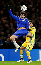 Diego Costa of Chelsea heads the ball in the compete in the air as Ricardo Esgaio of Sporting challenges - Photo mandatory by-line: Rogan Thomson/JMP - 07966 386802 - 10/12/2014 - SPORT - FOOTBALL - London, England - Stamford Bridge - Sporting Clube de Portugal - UEFA Champions League Group G.