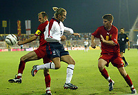 Photograph: Scott Heavey.<br />England v Macadonia at the City Stadium in Skopje, Macadonia. 05/09/2003.<br />David Beckham flicks the ball up in the corner to waste time in the final minutes.