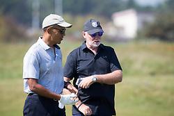 Former US president Barack Obama playing golf at St Andrews. With Sir Tom Hunter.