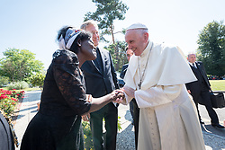 """21 June 2018, Geneva, Switzerland: On 21 June 2018, the World Council of Churches receives a visit from Pope Francis of the Roman Catholic Church. Held under the theme of """"Ecumenical Pilgrimage - Walking, Praying and Working Together"""", the landmark visit is a centrepiece of the ecumenical commemoration of the WCC's 70th anniversary. The visit is only the third by a pope, and the first time that such an occasion was dedicated to visiting the WCC. Here, an ecumenical prayer service with religious leaders from all over the world. Here, Pope Francis is greeted Dr Agnes Abuom (Moderator of the WCC Central Committee, , Anglican Church of Kenya) as the Pope arrives at the Ecumenical Centre."""