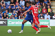 AFC Wimbledon defender Tennai Watson (2) battles for possession with Scunthorpe United midfielder Josh Morris (11) during the EFL Sky Bet League 1 match between AFC Wimbledon and Scunthorpe United at the Cherry Red Records Stadium, Kingston, England on 15 September 2018.