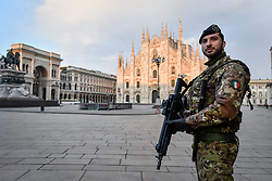 March 20, 2020, Milan, Italy: An Army military soldier is stationed at Piazza Duomo. Military soldiers are deployed to control the movement of the population during the coronavirus emergency.  (Credit Image: © Claudio Furlan/LaPresse via ZUMA Press)