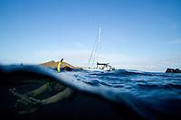 Young woman snorkeling in the Galapagos Islands, Ecuador.