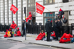 © Licensed to London News Pictures. 05/02/2020. London, UK. Greenpeace activists block entrances and lock themselves to railings infront of BP's London Headquarters. This protest comes on Bernard Looney's first day as CEO of BP. Photo credit: George Cracknell Wright/LNP