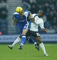 Photo: Aidan Ellis.<br /> Preston NE v Cardiff City. Coca Cola Championship.<br /> 19/11/2005.<br /> Cardiff's Darren Purse beats Preston's Jemal Johnson to the ball