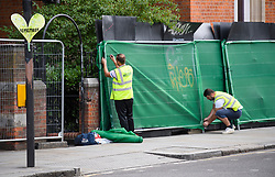 © Licensed to London News Pictures. 24/08/2018. London, UK. Preparations are made to protect buildings around Notting Hill, West London ahead of the 2018 Notting Hill Carnival which starts this weekend. Photo credit: Ben Cawthra/LNP