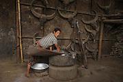 Konyak Naga winnowing rice<br /> Konyak Naga headhunting Tribe<br /> Mon district<br /> Nagaland,  ne India