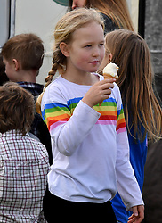 Savannah Phillips enjoying an ice cream during the Land Rover Novice & Intermediate Horse Trials at Gatcombe Park on March 23, 2019.
