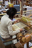 Nishijin Textile Center Weaver ,  at the very crossroads of the silk and kimono craftsmanship in Kyoto for centuries.  When the capital of Japan was moved from Kyoto to Tokyo, its very existence was threatened but the local weavers, kimono designers and associated craftsmen adapted and Nishijin is still around today occupying the same space as it has for hundreds of years.  Nishijin also serves as an educational center and puts on kimono fashion shows every day to increase awareness and appreciation of Kyoto silk, kimono and local crafts.