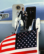 White House official photographer Michael evans waits at the top of the stair of Air Force One.  <br />Photo by Dennis Brack. bb77