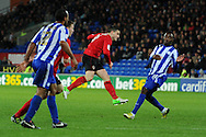 Craig Conway of Cardiff city © shoots and scores the opening goal. NPower championship, Cardiff city v Sheffield Wednesday at the Cardiff city Stadium in Cardiff on Sunday 2nd Dec 2012. pic by Andrew Orchard, Andrew Orchard sports photography,