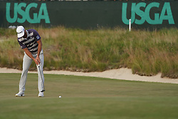 June 16, 2018 - Southampton, NY, USA - Dustin Johnson putting on the 16th green during the third round of the 2018 U.S. Open at Shinnecock Hills Country Club in Southampton, N.Y., on Saturday, June 16, 2018. (Credit Image: © Brian Ciancio/TNS via ZUMA Wire)