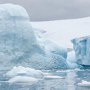Large icebergs float near the shore of Melchior Island on the Antarctic Peninsula.