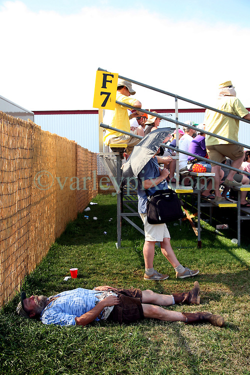 05 May 2012. New Orleans, Louisiana,  USA. .New Orleans Jazz and Heritage Festival. .Sleeping off a bit of Jazzfest..Photo; Charlie Varley.