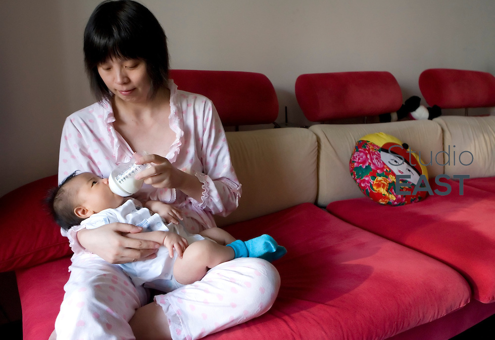 SHANGHAI, CHINA - August 15: Mother Han Songjun gives milk to her 1-month-old son Pengpeng on August 15, 2009 in Shanghai, China. (Photo by Lucas Schifres/Getty Images)