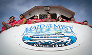 SHOT 10/21/17 1:13:44 PM - Tourists get a front row seat for prime viewing on the Maid of the Mist boat tour in Niagara Falls, N.Y. The Maid of the Mist is a boat tour of Niagara Falls, starting and ending on the American side, crossing briefly into Ontario during a portion of the trip. The boat starts off at a calm part of the Niagara River, near the Rainbow Bridge, and takes its passengers past the American and Bridal Veil Falls, then into the dense mist of spray inside the curve of the Horseshoe Falls, also known as the Canadian Falls. The tour starts and returns on the U.S. side of the river. (Photo by Marc Piscotty / © 2017)