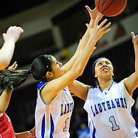 031213  Adron Gardner/Independent<br /> <br /> Laguna Acoma Hawks Lacey Natseway (15), left, and Raquel Aguino (1) reach for a rebound during the 2A New Mexico High School Basketball tournament quarterfinals at the Santa Ana Star Center in Rio Rancho Tuesday.