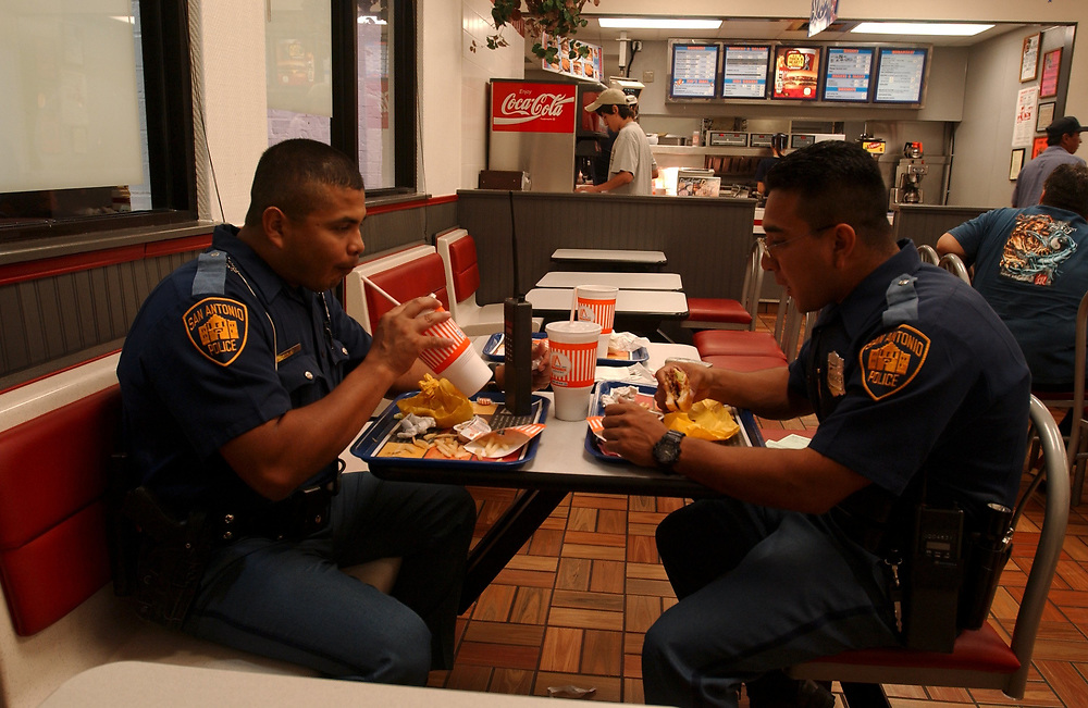 San Antonio, Texas August 7-8, 2003: Police officers take a break and eat at Whataburger fast-food place. ©Bob Daemmrich