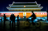 Tourist photograph themselves as they look at the lighted front entrance to the Forbidden City in Beijing China, Monday Nov. 14, 2005.