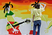 Moscow, Russia, 10/07/2004..Several thousand people attend ETNA, Russia's largest festival of ethnic and world music; this year's festival featured artists from four continents. .Graffiti artists paint a mural in the Hermitage Garden.