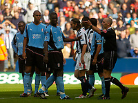 Photo. Glyn Thomas. Digitalsport<br /> West Bromwich Albion v Fulham. <br /> Barclays Premiership. 18/09/2004.<br /> Fulham's Papa Bouba Diop (C) contests referee M. Dean's (R) decision to award a penalty for a Moritz Voltz handball. Robert Earnshaw missed the chance to put West Brom ahead.