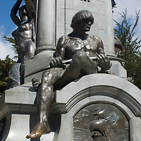 A sculpture of a Patagonian Indian sits atop a bas relief of Magellan's ships in the plaza of Punta Arenas, Chile.