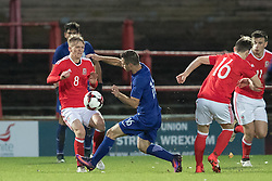WREXHAM, WALES - Thursday, November 10, 2016: Wales' Matthew Smith in action against Spyros Natsos of Greece during the UEFA European Under-19 Championship Qualifying Round Group 6 match at the Racecourse Ground. (Pic by Gavin Trafford/Propaganda)