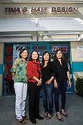 Tina's Hair Design employees Jennifer Lu, Hue Luu, Helen Do (left to right) and owner Tina Chang (red) pose for a portrait outside Tina's Hair Design in Milpitas, California, on September 11, 2014. (Stan Olszewski/SOSKIphoto)