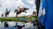 April 29, 2017, 22nd annual Queen's Cup Steeplechase. HENRY SAN and Jockey Darren Nagle lead SYROS and DOC CEBU over the water jump during the 4th race.