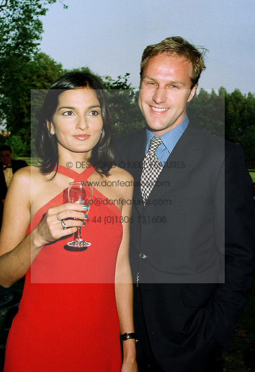 MR & MRS SIMON MILLS, he is editor of GQ Active magazine, at a ball in London on 17th June 1997.LZL 10