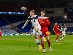 CARDIFF, WALES - Wednesday, November 18, 2020: Finland's Robin Lod (L) and Wales' James Lawrence during the UEFA Nations League Group Stage League B Group 4 match between Wales and Finland at the Cardiff City Stadium. Wales won 3-1 and finished top of Group 4, winning promotion to League A. (Pic by David Rawcliffe/Propaganda)