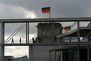 Figures cross bridges above the Spree river, the line of the former Cold War barrier which was opened 15 years ago on 9th November 1989. This area behind the Reichstag (parliament) has been redeveloped and has become home to civil servants and other officials since the German government was moved from Bonn to Berlin.
