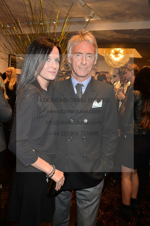 PAUL WELLER and HANNAH ANDREWS at a party to celebrate the launch of the first European John Varvatos Store, 12-13 Conduit Street, London held on 3rd September 2014.