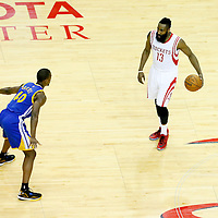 23 May 2015: Golden State Warriors forward Harrison Barnes (40) defends on Houston Rockets guard James Harden (13) during the Golden State Warriors 115-80 victory over the Houston Rockets, in game 3 of the Western Conference finals, at the Toyota Center, Houston, Texas, USA.