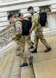 © Licensed to London News Pictures. 18/07/2012. Westminster, UK Soldiers walk down steps near to the Foreign Office. Soldiers, police and security contractors perform security checks around Olympic sites in Westminster today, 18th July 2012. Photo credit : Stephen Simpson/LNP