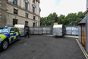 Police are seen barricading King Charles Street outside the Foreign & Commonwealth Office ahead of the Extinction Rebellion weeks of protests to start on Monday. Additional police forces including members of traffic police as well as territorial support groups are seen driving around central London on Sunday, Aug 22, 2021. (VX Photo/ Vudi Xhymshiti)