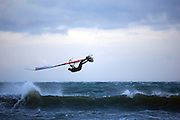 Windsurfer flies through the air sideways, Dollymount Beach, Bull Island, Dublin, Ireland