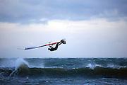 Windsurfer flies through the air sideways, Dollymount Beach, Bull Island, Dublin, Ireland