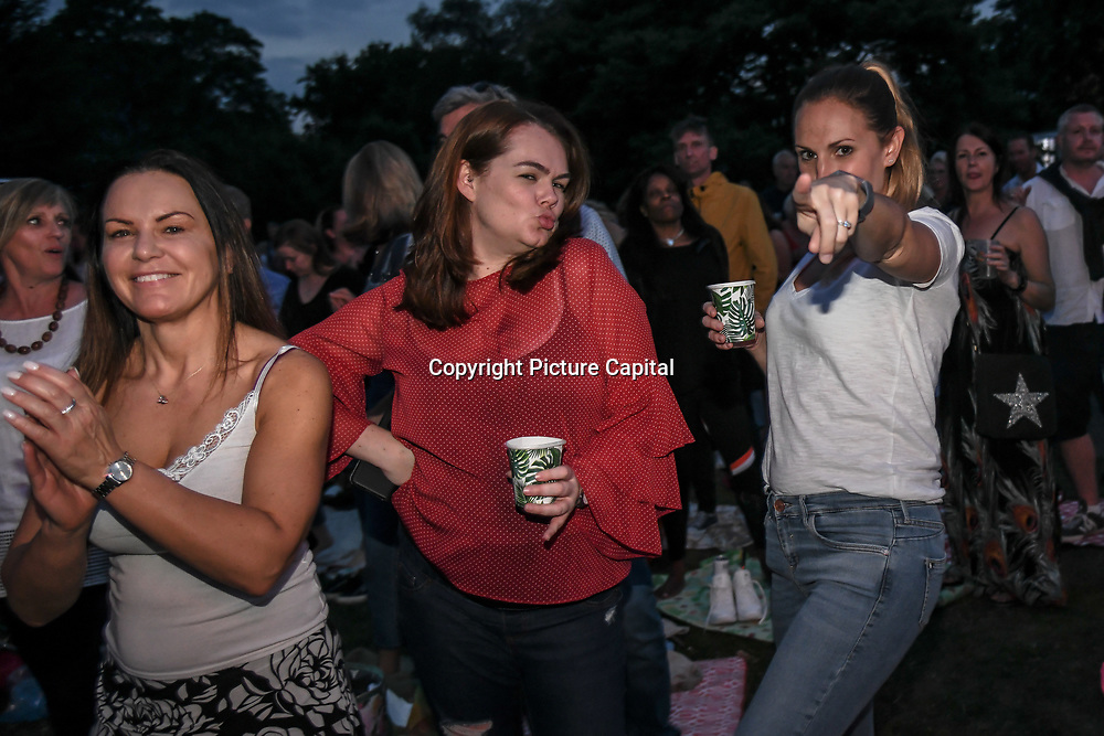 Attendees enjoy themselves at Kew The Music 2019 on 9 July 2019, Kew Garden, London, UK.