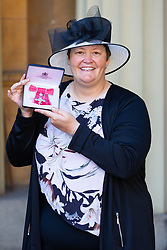 Suzanne Redfern proudly displays her MBE for services to Cricket in the UK and abroad following an investiture ceremony at Buckingham Palace in London. London, March 14 2019.