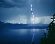 CS00003-18. Rain shower and lightning strike at Crater Lake, Oregon. Ca. 1940