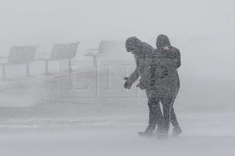 © Licensed to London News Pictures. 09/02/2020. Portsmouth, UK. People watch as high waves are seen at Southsea, Portsmouth as Storm Ciara batters the UK. Airlines have cancelled dozens of domestic and international flights as the storm brings strong winds and rain. Photo credit: Peter Macdiarmid/LNP
