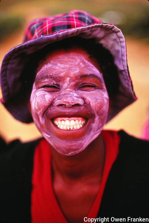 A smiling woman wine harvest worker in Stellenbosch, South Africa