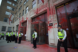 © Licensed to London News Pictures.  27/08/2021. London, UK. Members of Extinction Rebellion  stained Corporation of London with artificial blood as demonstration marching through central London. They protesting against the use of Fossil fuels. Photo credit: Marcin Nowak/LNP