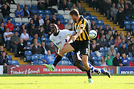 Bury's Jessy Reindorf is sent flying by the tackle from Southend's Mark Phillips (5). Skybet football league two match, Bury v Southend Utd at Gigg Lane in Bury, England on Sat 21st Sept 2013. pic by David Richards/Andrew Orchard sports photography