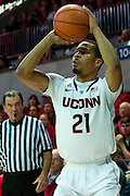 DALLAS, TX - JANUARY 4: Omar Calhoun #21 of the Connecticut Huskies shoots the ball against the SMU Mustangs on January 4, 2014 at Moody Coliseum in Dallas, Texas.  (Photo by Cooper Neill) *** Local Caption *** Omar Calhoun