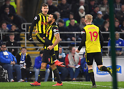 Watford's Gerard Deulofeu (left) celebrates scoring his side's second goal of the game with team-mates Troy Deeney and Will Hughes (right) during the Premier League match at the Cardiff City Stadium.