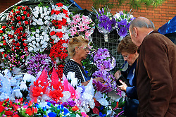 November 1, 2018 - L´Hospitalet, Barcelona, Spain - The entrance to the Municipal Cemetery of L'Hospitalet City where a woman buys flowers at a market for the grave of a relative..Spain celebrates the day of the deceased where family and friends visit the cemeteries where their deceased relatives rest. (Credit Image: © Ramon Costa/SOPA Images via ZUMA Wire)