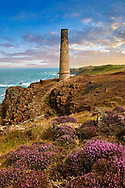 Ruined Chimney of a Cornish Tin Mine, Cornwall . The Botallack Mine  is a former mine in Botallack in the west of Cornwall, England, UK. Since 2006 it has been part of the UNESCO World Heritage Site – Cornwall and West Devon Mining Landscape. The mine is within the Aire Point to Carrick Du Site of Special Scientific Interest (SSSI) and the South West Coast Path passes along the cliff..<br /> <br /> Visit our ENGLAND PHOTO COLLECTIONS for more photos to download or buy as wall art prints https://funkystock.photoshelter.com/gallery-collection/Pictures-Images-of-England-Photos-of-English-Historic-Landmark-Sites/C0000SnAAiGINuEQ